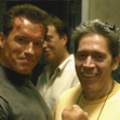 Arnold Schwarzenegger and Mario Kassar on the set
